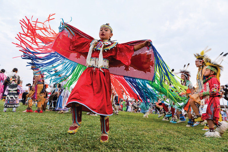 Ashleigh Fox | The Sheridan Press<br /> A young girl twirls in the powwow circle during the 100th Crow Fair Friday, Aug. 17, 2018.