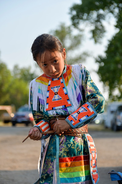 Ashleigh Fox | The Sheridan Press<br /> Skylar Benson fixes his belt before the grand march during the 100th Crow Fair Friday, Aug. 17, 2018.