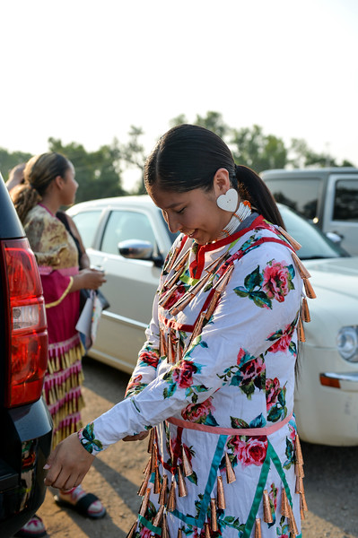 Ashleigh Fox | The Sheridan Press<br /> Jayda Weaseltail fixes her dress before the grand march during the 100th Crow Fair Friday, Aug. 17, 2018.