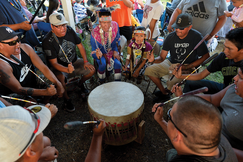 Ashleigh Fox | The Sheridan Press<br /> Members of the Crow Agency drum circle, Night Hawk Jrz, sing during the 2018 Crow Fair competition Friday, Aug. 17, 2018.