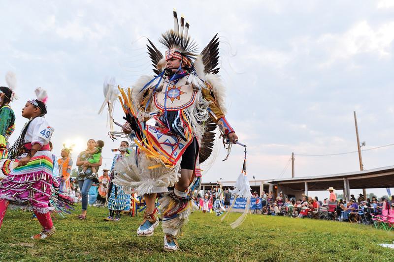 Ashleigh Fox | The Sheridan Press<br /> A man dances along the edge of the powwow circle during the 100th Crow Fair Friday, Aug. 17, 2018.
