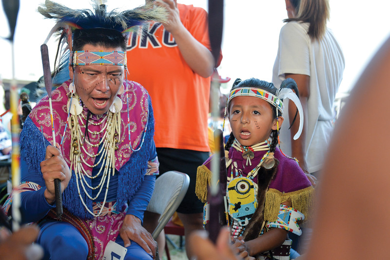 Ashleigh Fox | The Sheridan Press<br /> Prinz Three Irons, left, and Jacoby Little Light of the Crow Agency drum circle, Night Hawk Jrz, sing during the 2018 Crow Fair competition Friday, Aug. 17, 2018.