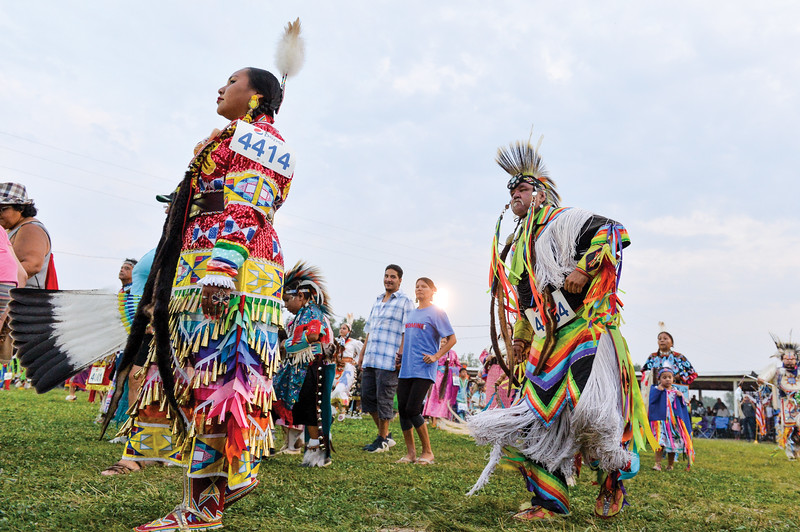 Ashleigh Fox | The Sheridan Press<br /> People dance along the edge of the powwow circle during the 100th Crow Fair Friday, Aug. 17, 2018.