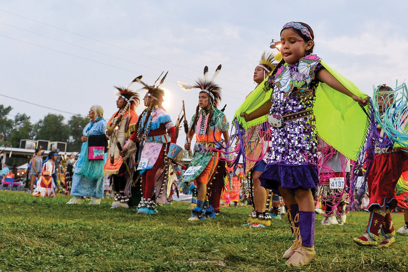 Ashleigh Fox | The Sheridan Press<br /> A young girl dances along the edge of the powwow circle during the 100th Crow Fair Friday, Aug. 17, 2018.