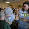 Susie Ritchey is hugged by her grandmother Dorothy Rizzi while her mother Cindy Ritchey cries after Susie's hair was shaved off for the St. Baldrick's Foundation fundraiser at Papa Frank's  Restaurant. Susie organized the event that raised over $11,000 for pediatric cancer research.<br /> <br /> March 20, 2010<br /> Staff photo/David R. Jennings