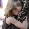 Hadley Olsen, 6, holds on to her father Tyler while waiting in line for the first day of school at Coyote Ridge Elementary School.<br /> August 18, 2010<br /> staff photo/David R. Jennings