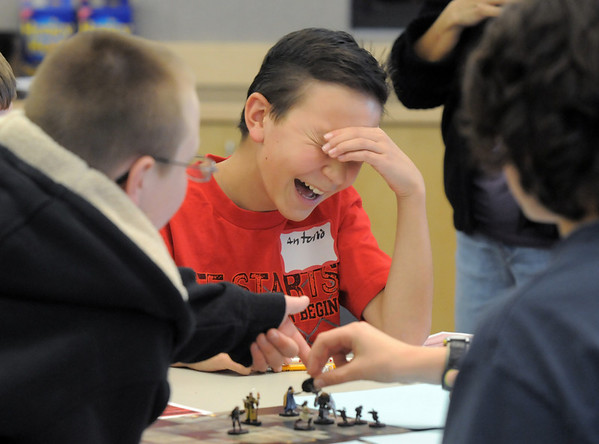 Antonio Cabrera, 11, laughs while playing a dungeons and dragons game at Mamie Doud Eisenhower Public Library in celebration of National Gaming Day sponsored by Total Escape Games.<br /> November 20, 2010<br /> staff photo/David R. Jennings