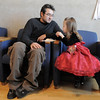 Bill Johnson and his daughter Kaitlyn, 3, share cookies after the Early Learning Annual Holiday Program  at the Audi. <br /> December 4, 2010<br /> staff photo/David R. Jennings