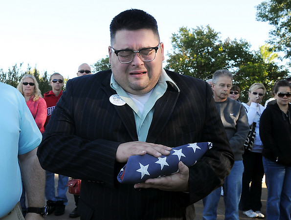 Joshua Miller holds the flag presented to him in honor of his friend Deora Bodley who died on Flight 93 during the ceremony at the 9/11 Memorial.<br /> <br /> September 11, 2010<br /> staff photo/David R. Jennings