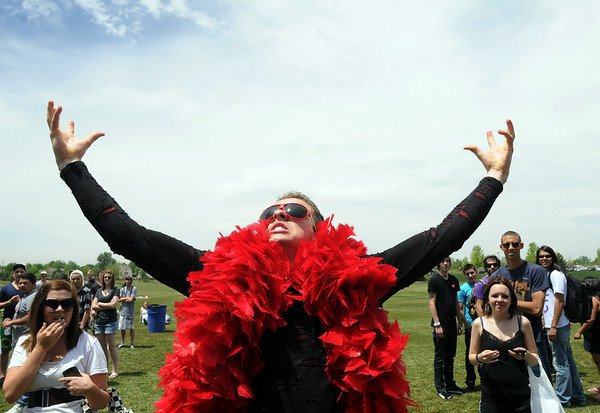 Carter James, 21, dance wearing a red boa during  Broomstock 2010 at the Broomfield County Commons. <br /> May 27, 2010<br /> Staff photo/ David R. Jennings