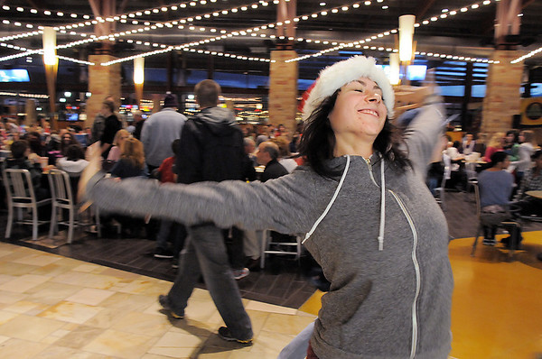 """Break EFX dancer Hannah Vincent begins dancing leading over 200 people to dance in a flash mob to Mariah Carey's song """"All I want for Christmas is you"""" in the food court of FlatIron Crossing mall on Thursday. Dancers in the flash mob were from Artistic Fusion Dance Academy and Break EFX Boulder/Denver. <br /> December  9, 2010<br /> staff photo/David R. Jennings"""