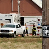 Investigators and crews worked throughout Wednesday to clear the remains of as many as 100 animals found dead at a farm on County Road 1700 North near 350 West Tuesday night.
