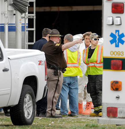 Madison County Sheriff Ron Richardson talks with other personnel Wednesday at  the scene of where dozens of dead animals were found on a farm on 1700 North near 350 West Tuesday night.
