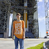 Michael standing in front of the Delta IV