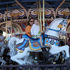 Rob and Addison taking a merry go round ride