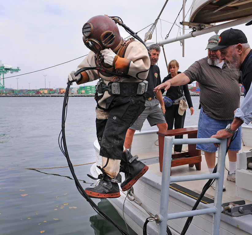 . Torrance R. Parker, an 85 year-old diver, leaps into the water of San Pedro channel. He has written a second book, - 20,000 Divers Under the Sea. Event hosted at the Martime Museum in San Pedro where his new book is sold. (Wed., 10/23/13 Photo by Brad Graverson/The Daily Breeze)