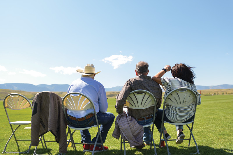 Ashleigh Fox | The Sheridan Press<br> Folks watch the calcutta events on the east side of the Big Horn Equestrian Center field during Don King Days Sunday, Sept. 2, 2018.