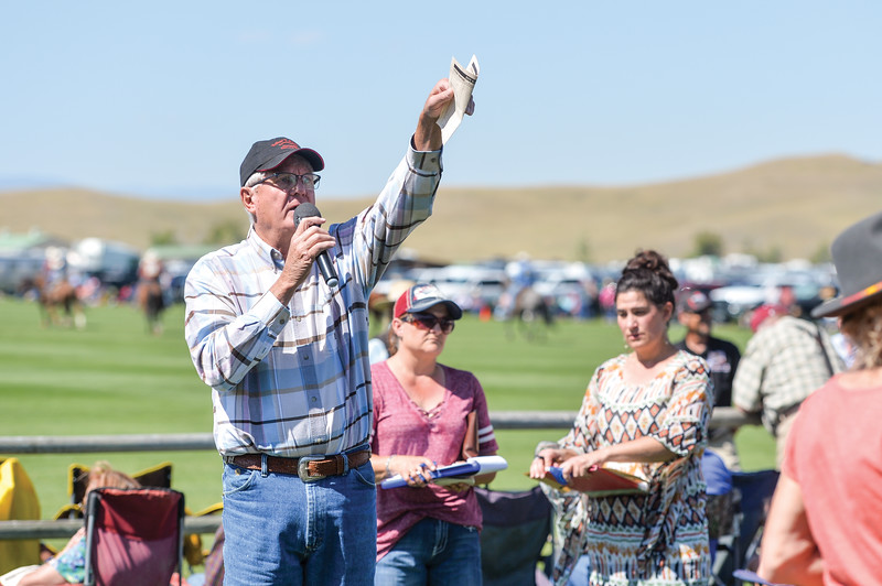Ashleigh Fox | The Sheridan Press<br> Semi-retired auctioneer Jay Godly from Buffalo works for calcutta bids at the Big Horn Equestrian Center during Don King Days Sunday, Sept. 2, 2018.