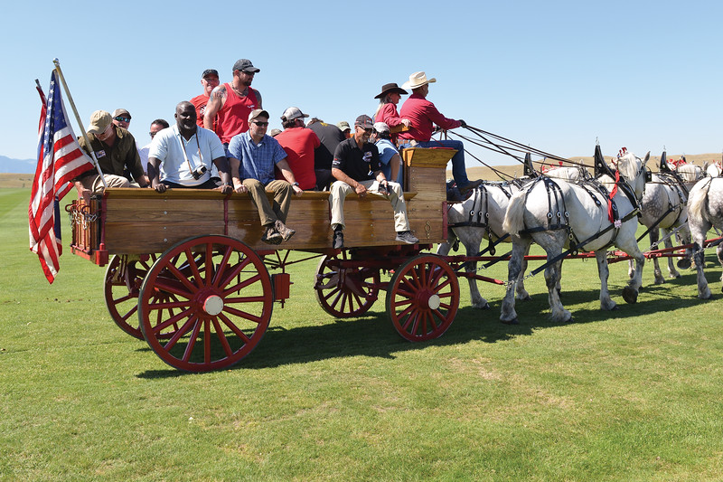 Ashleigh Fox | The Sheridan Press<br> Veterans participating in the WYO West Warrior Foundation weekend take a ride on a horse-driven wagon during Don King Days Sunday, Sept. 2, 2018.