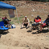 We were camping overnight but this is the day camp. We towed the Easy-Up and chairs in Dan's towable raft. Sandi, Dave, Gloria, and Dan are relaxing between rides.