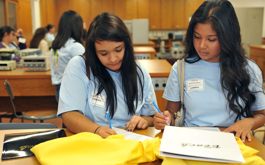 . 10/4/13 - L-R Edith Silva and Sasima Rattanathan fill out their paperwork before a workshop. Some 200 middle school and high school girls from school districts in Long Beach, Montebello and Paramount will take part in Cal State Long Beach�s �Women Engineers at The Beach,� a program developed to inspire young girls to consider careers in engineering, technology and computer science. (Photo by Brittany Murray/Press Telegram)
