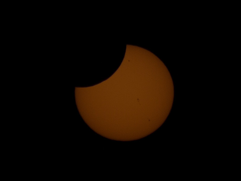 Eclipse nearly finished, with three prominent sun spots
