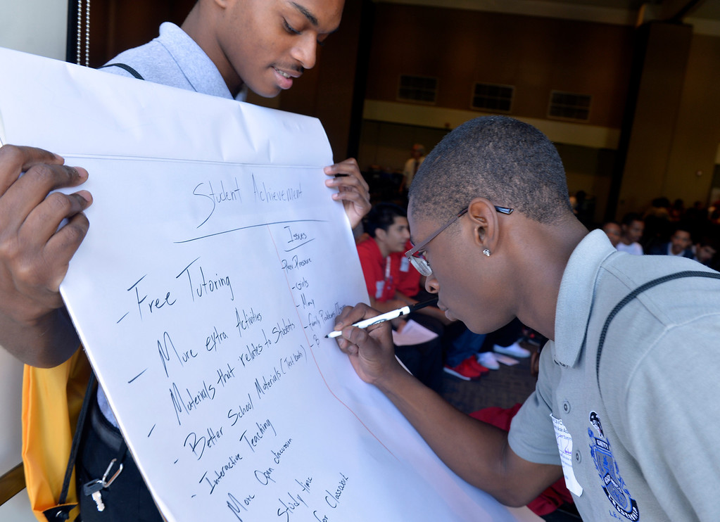 . James Easrtland, left, and Robert Dashiell, right, wrights a list as they help with a group of male students as about three hundred middle and high school male students gathered at Cal State Long Beach for the first ever Boys and Men of Color Summit, �Turn Up For Change,� a day of action and developing recommendations toward improving supports, resources and opportunities for students of color in communities and schools in Long Beach, CA. February 25, 2014. (Thomas R. Cordova Daily Breeze/Press-Telegram)