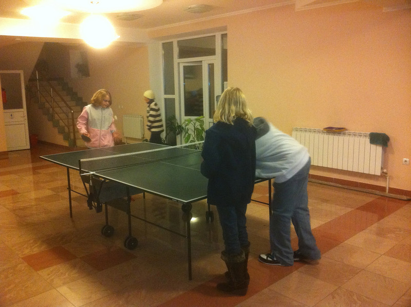 Ping pong in the church basement -- Irena's mom is in the background.