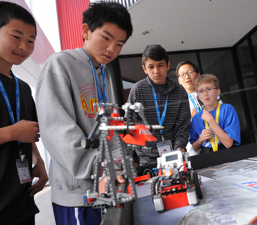 . Lego robotics group L to R are: Anthony Handa, Evan Eguchi, Arman Banihashemi, Andrew Choi and Kellan Jack. Math Moves U Day, part of National Engineer\'s Week at Raytheon Space and Airborne Systems in El Segundo. This day, middle school kids did hands-on activities like Lego robotics and straw rockets, as well as a math contest and lots of computer stuff. (Tues. Feb 17, 2014 Photo by Brad Graverson/The Daily Breeze)