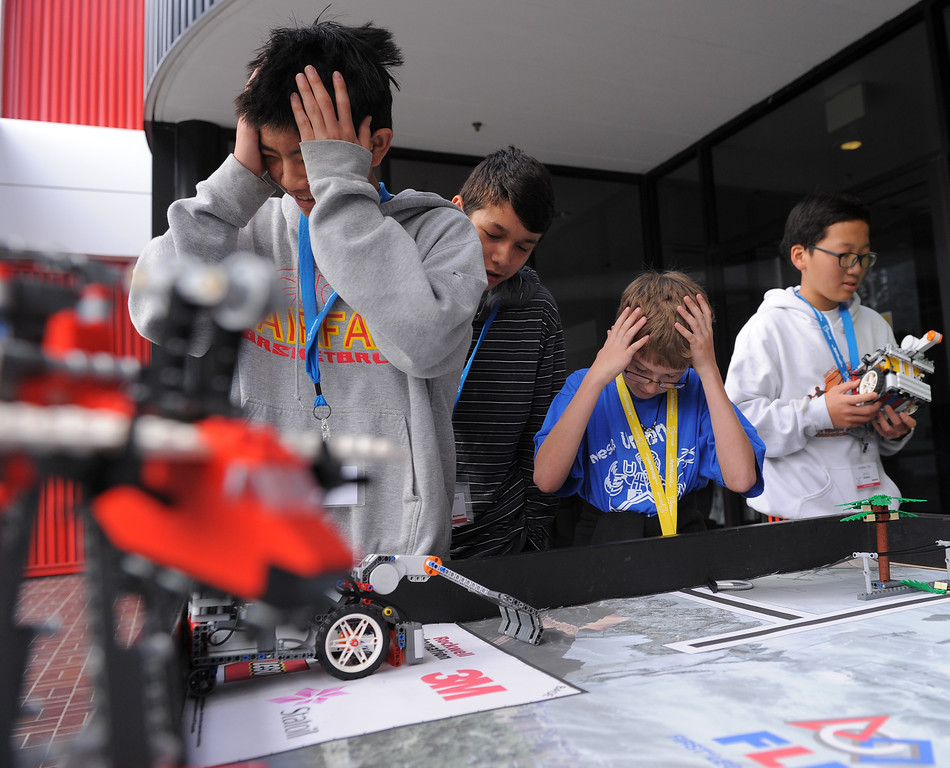 . A bit of robotic angst as a Lego robot veers off course. Lego robotics group L to R are:  Evan Eguchi, Arman Banihashemi, Kellan Jack and Andrew Choi.  Math Moves U Day, part of National Engineer\'s Week at Raytheon Space and Airborne Systems in El Segundo. This day, middle school kids did hands-on activities like Lego robotics and straw rockets, as well as a math contest and lots of computer stuff. (Tues. Feb 17, 2014 Photo by Brad Graverson/The Daily Breeze)