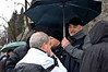 Fr. Oliveriero was one of the smart ones who thought to bring an umbrella