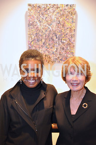Rosetta DeBerardinis with her work, and Donna Evers Evers & Co. Art Exhibition, November 17, photo by Ben Droz