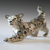 "sn. 771 Snow Leopard, stoneware.  16"" x 6"" x 4"".  $200."