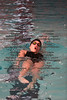 FHS's Meghan Quaid swims the back stroke in the girls 200 yard IM.