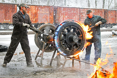Dave Weik (L) and Dirk Caloccia (R) remove a Shay locomotive tire on a cold January morning in 2012.   Note: Dave no longer works for the railroad.