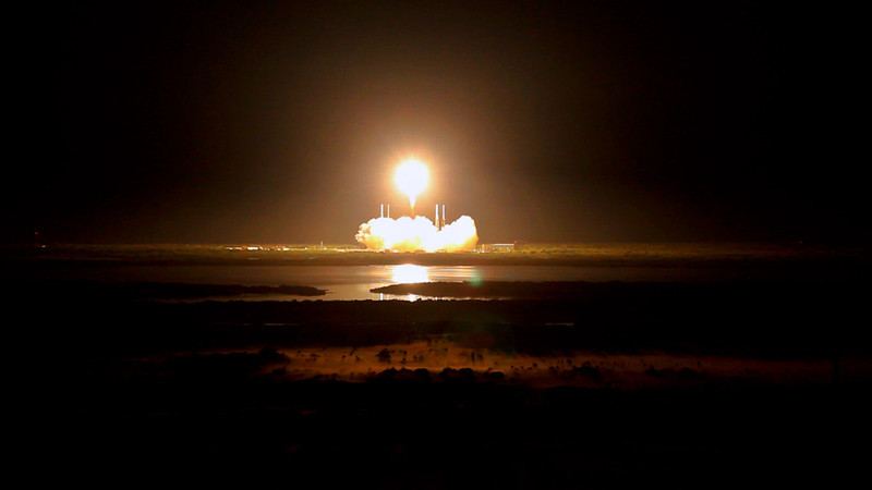 Space X Falcon 9 on its way to the International Space Station.  Shot from the roof of the Vehicle Assembly Building.
