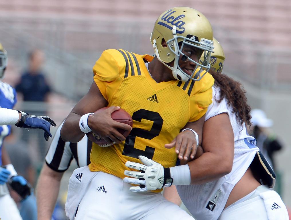 . UCLA Bruins quarterback Asiantii Woulard (2) during a NCAA college spring football game at the Rose Bowl in Pasadena, Calif., Saturday, April 25, 2015. (Photo by Keith Birmingham/ Pasadena Star-News)