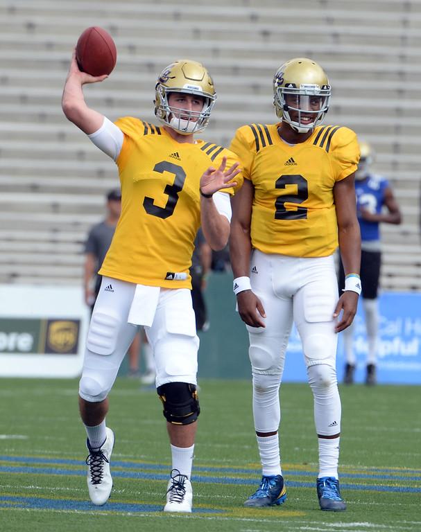 . UCLA Bruins quarterback Josh Rosen (3) passes as quarterback Asiantii Woulard (2) looks on during a NCAA college spring football game at the Rose Bowl in Pasadena, Calif., Saturday, April 25, 2015. (Photo by Keith Birmingham/ Pasadena Star-News)