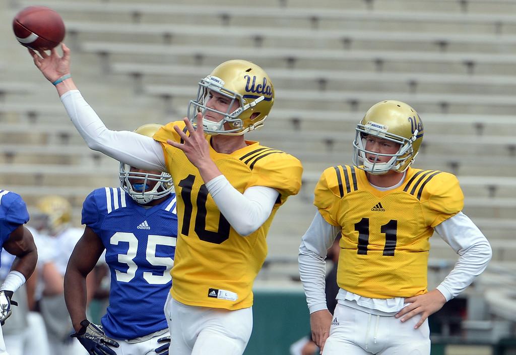 . UCLA Bruins quarterback Jake Hall (10) passes as quarterback Jerry Neuheisel (11) looks on during a NCAA college spring football game at the Rose Bowl in Pasadena, Calif., Saturday, April 25, 2015. (Photo by Keith Birmingham/ Pasadena Star-News)