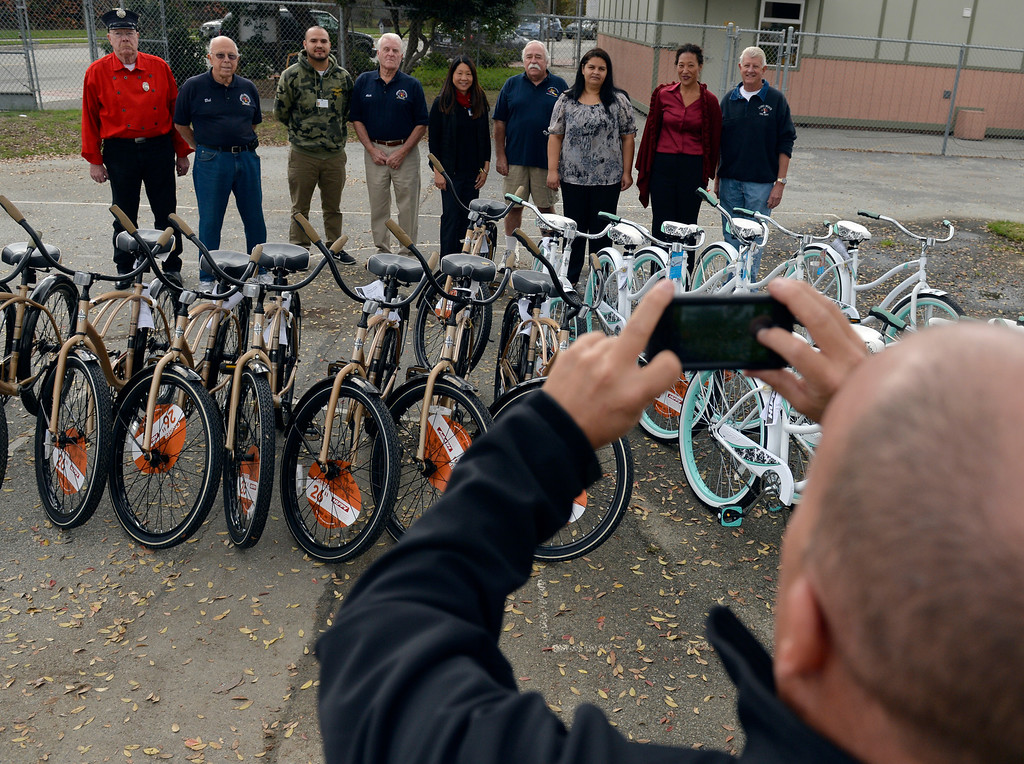 . The Long Beach Fire Honoraries have spent months raising money to donate 22 bikes to local high school students, working in conjunction with the Long Beach Unified School District as they give out the bikes in Long Beach, CA. December 3, 2013. The  Long Beach Unified School District have picked 11 boys and 11 girls who they feel are deserving of receiving a new bike for the Christmas season, helmets and locks are included. (Thomas R. Cordova/Press-Telegram/Daily Breeze)