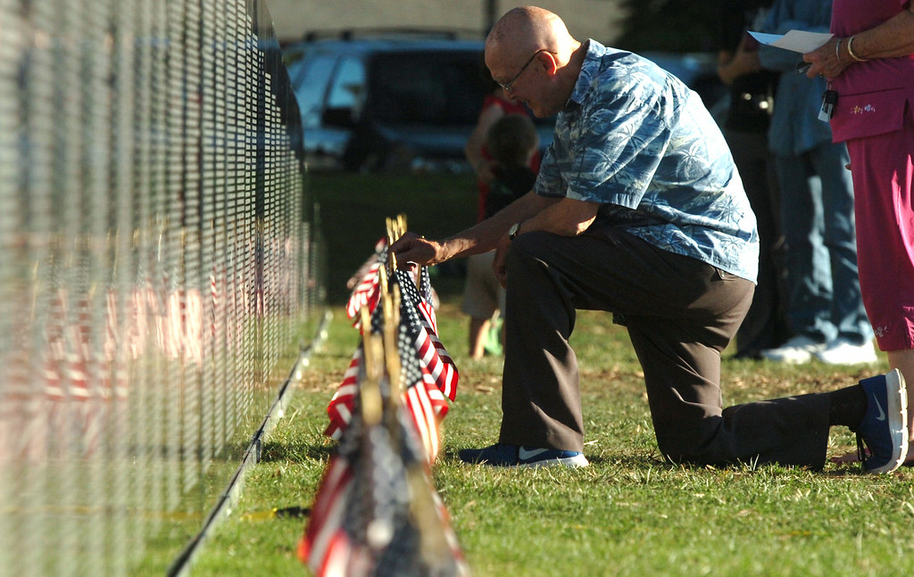. The traveling Vietnam Veterans Memorial Wall on displayed in Lakewood\'s Mayfair Park in Lakewood CA. Thursday August 14, 2014. The teaveling wall is 80 percent-sized replica is 360-feet long. (Thomas R. Cordova-Daily Breeze/Press-Telegram)