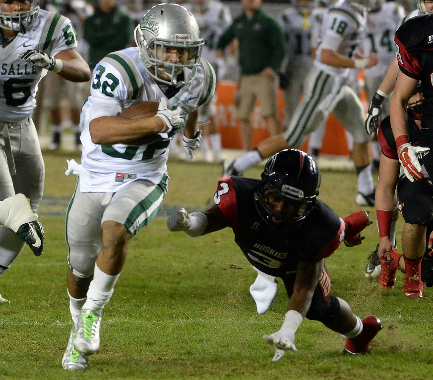 . De La Salle\'s Andrew Hernandez (32) runs for touchdown past Centennial\'s Jihree Stewart (C) (3) in the first half of a CIF-State Football Championship game at the Stub Hub Center in Carson, Calif., Saturday, Dec. 20, 2014. (Photo by Keith Birmingham/ Pasadena Star-News)