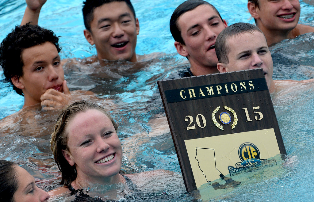 . Crean Lutheran\'s Ella Eastin holds the championship plaque as they celebrate winning the team championships during the CIF division 2 swimming finals in the Riverside Aquatics Complex at Riverside City College in Riverside, Calif., on Saturday, May 16, 2015.  (Photo by Keith Birmingham/ Pasadena Star-News)