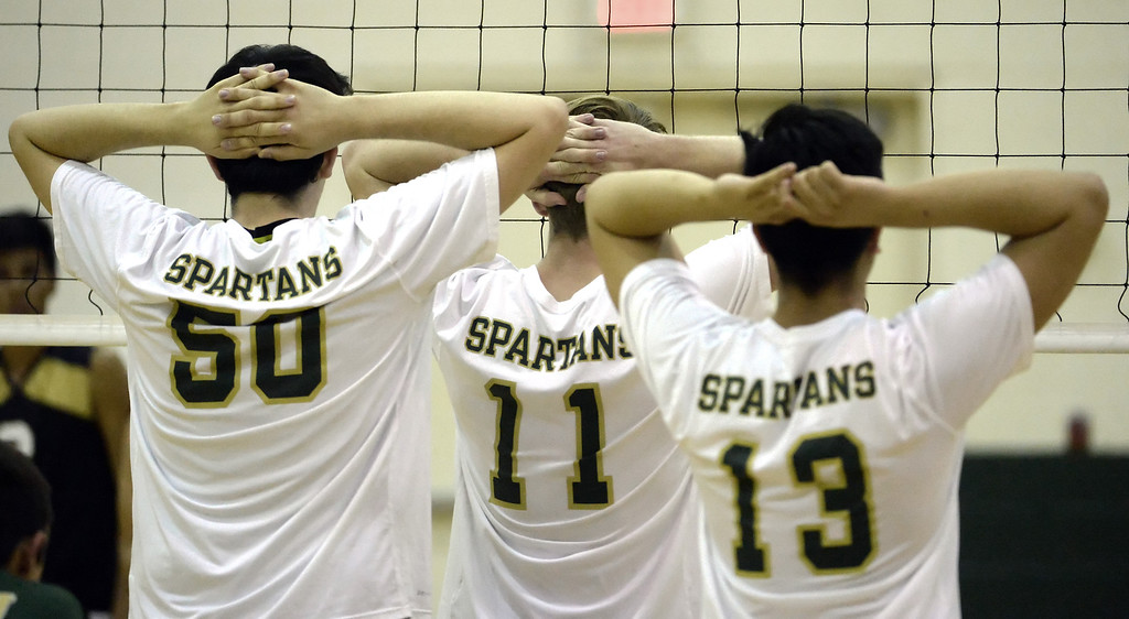 . Damien\'s Michael Spinney (50) John Prata (11) and Chris Mercado (13) prepares against Santa Fe in the first game of a prep volleyball match at Damien High School in La Verne, Calif., on Wednesday, May 20, 2015. Damien won 25-17, 25-19, 29-27. (Photo by Keith Birmingham/ Pasadena Star-News)