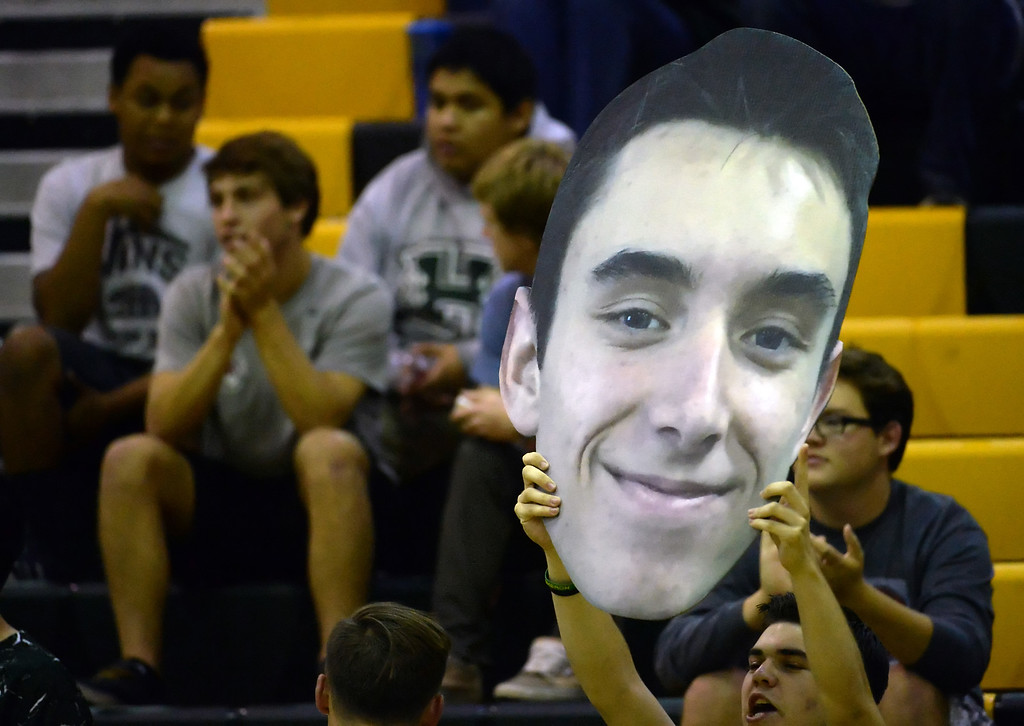 . A Damien fan holds-up a cut-out of a player against Santa Fe in the first game of a prep volleyball match at Damien High School in La Verne, Calif., on Wednesday, May 20, 2015. Damien won 25-17, 25-19, 29-27. (Photo by Keith Birmingham/ Pasadena Star-News)