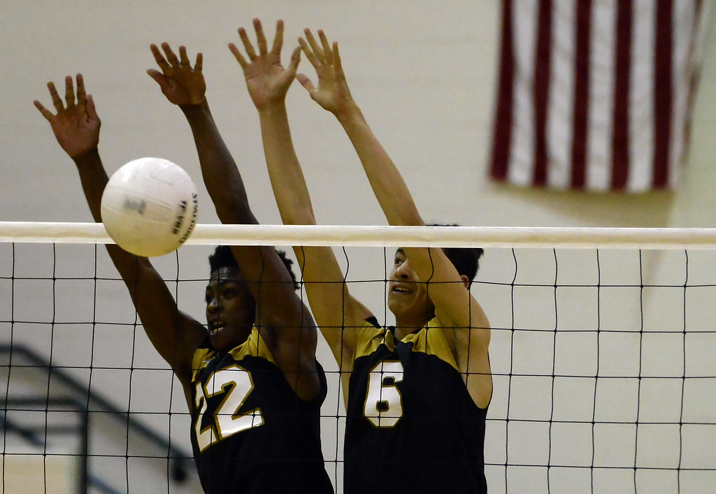. Santa Fe\'s Cameron Fisher (22) blocks a Damien shot along with Isaiah Canales (6) in the first game of a prep volleyball match at Damien High School in La Verne, Calif., on Wednesday, May 20, 2015.  (Photo by Keith Birmingham/ Pasadena Star-News)