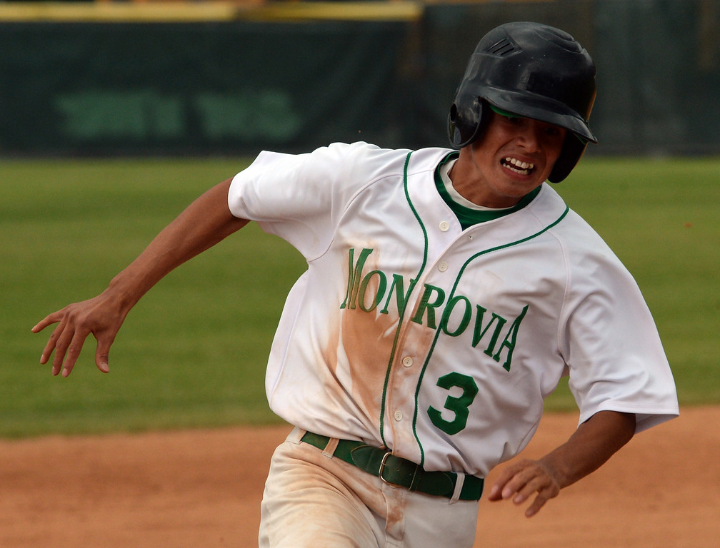 . Monrovia\'s Steven Ochoa scores on a double by Ben Goettling (not pictured) against Whittier Christian in the fourth inning of a prep playoff baseball game at Monrovia High School in Monrovia, Calif., on Thursday, May 21, 2015. Monrovia won 6-1.  (Photo by Keith Birmingham/ Pasadena Star-News)