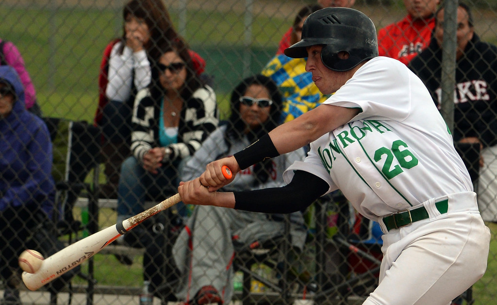 . Monrovia\'s Ben Goettling watches his RBI double against Whittier Christian in the fourth inning of a prep playoff baseball game at Monrovia High School in Monrovia, Calif., on Thursday, May 21, 2015. Monrovia won 6-1.  (Photo by Keith Birmingham/ Pasadena Star-News)