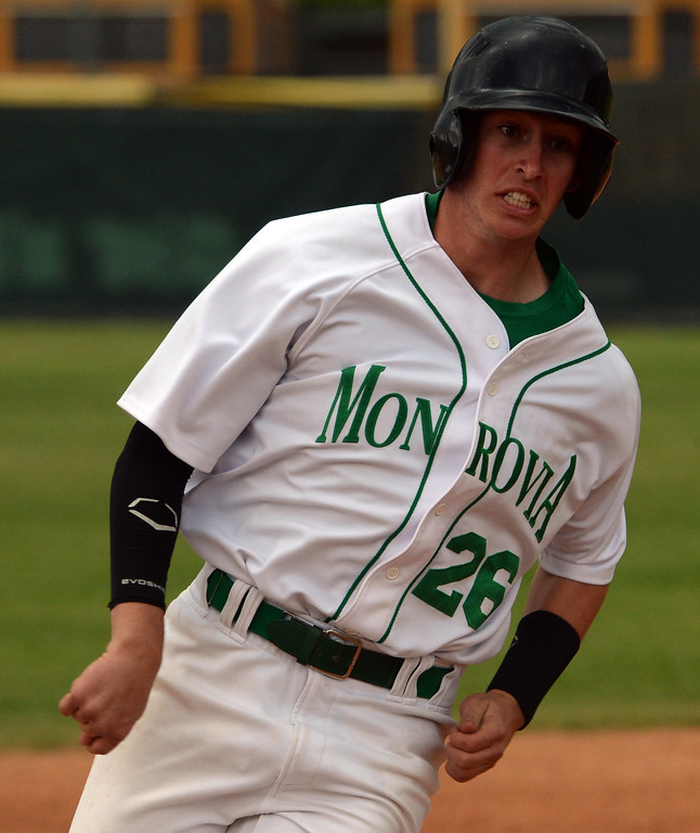 . Monrovia\'s Ben Goettling scores on a double by Juan Quinonez (not pictured) against Whittier Christian in the fourth inning of a prep playoff baseball game at Monrovia High School in Monrovia, Calif., on Thursday, May 21, 2015. Monrovia won 6-1.  (Photo by Keith Birmingham/ Pasadena Star-News)
