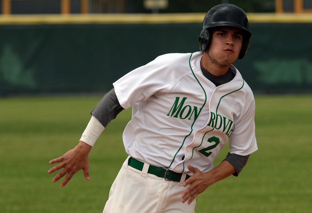 . Monrovia\'s Fidel Jiorge scores on a double by Juan Quinonez (not pictured) against Whittier Christian in the fourth inning of a prep playoff baseball game at Monrovia High School in Monrovia, Calif., on Thursday, May 21, 2015. Monrovia won 6-1.  (Photo by Keith Birmingham/ Pasadena Star-News)